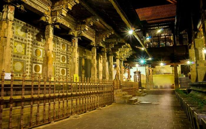 Well-lit interiors of Temple of Tooth Relic in Kandy