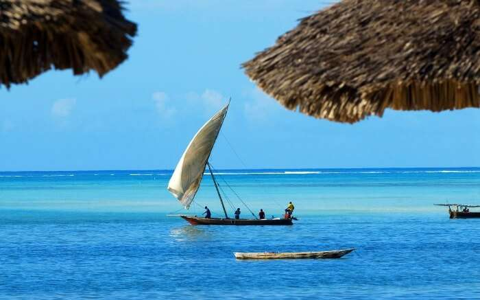 Zanzibar natives rowing a boat in the sea