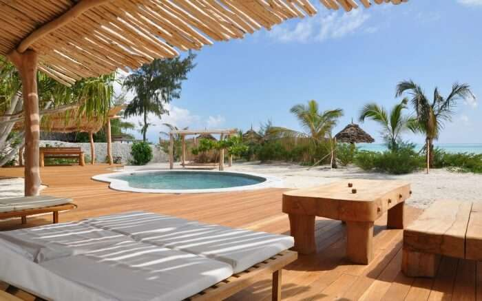 a private pool in a beachfront villa