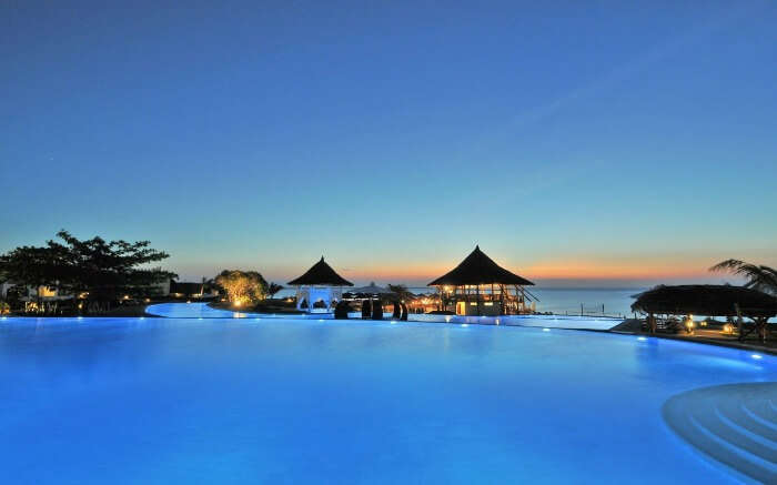 a vast pool in a resort overlooking the Indian Ocean