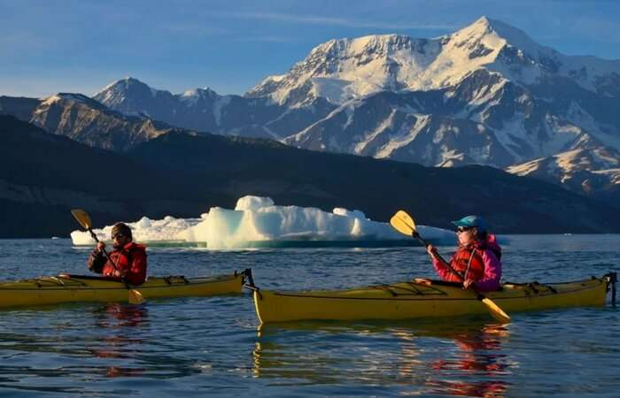 Couple canoeing in a lake in St. Elias National Park and Preserve in Alaska