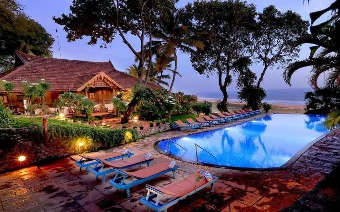 an outdoor pool with sea view in Somatheeram Ayurvedic Health Resortv