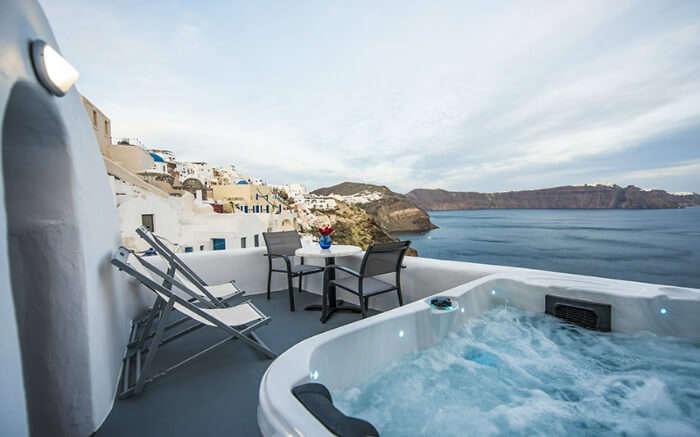 an outside pool overlooking a sea