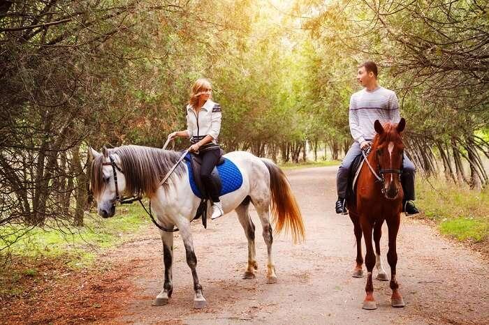 couple horse riding hyde park