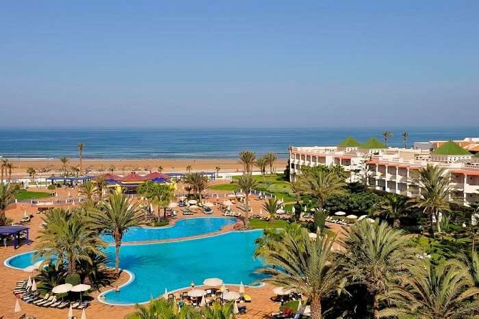 A view of the swimming pool and the beach in the backdrop of the Iberostar Founty Beach Hotel at Agadir in Morocco