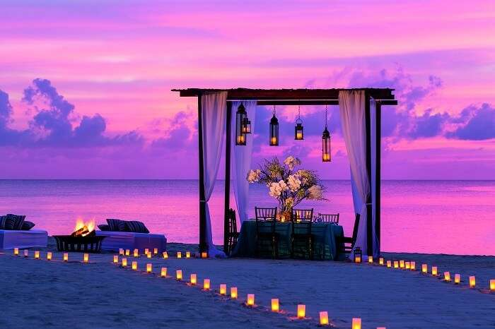 A candle-lit dining option at the Ritz Carlton beach with a draped gazebo for an intimate dinner on a honeymoon in Cayman Islands