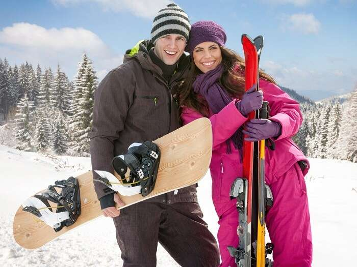 A couple trying adventure sports at a ski resort