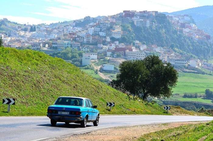 A chauffeur driven car taking a couple to the Holy City of Moulay Idriss on their Morocco honeymoon