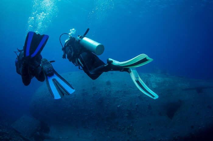 A couple exploring the shipwreck site at Aqaba in Jordan