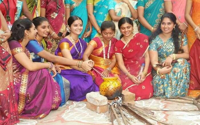 women cooking Pongal during Pongal festival