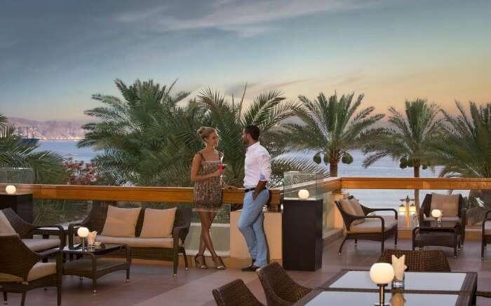 A couple talking on the terrace of a resort near Dead Sea