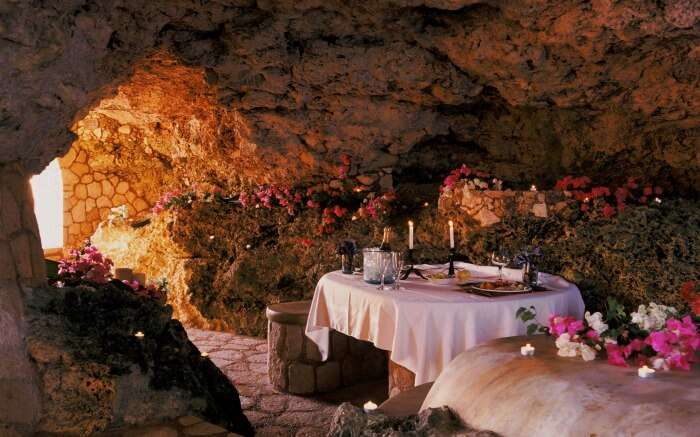 A romantic dining setting in a cave resort
