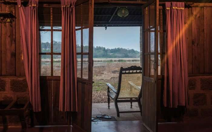 A room of Olaulim Backyards overlooking the vast stretch of land in Goa