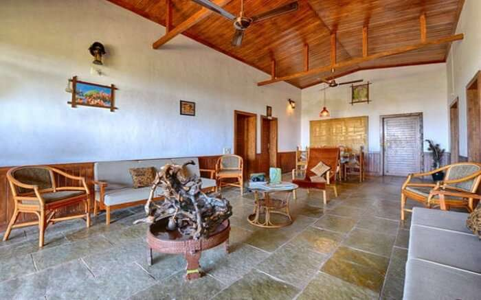 An interior view of the living area of Aranya Eco Farm Homestay in Gir