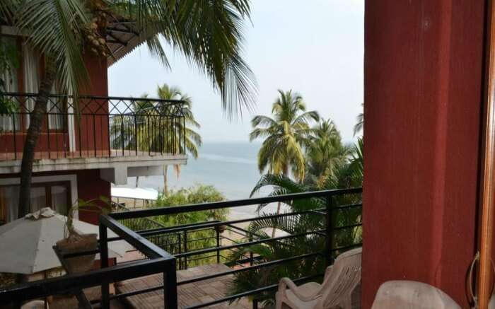 Balcony of Casa Tropicana Villa Caroline overlooking sea in Goa