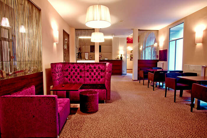Pink furniture with decorative lighting in a hotel room in Austria
