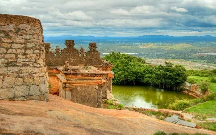 Channarayana Durga Fort overlooking a lake and hills