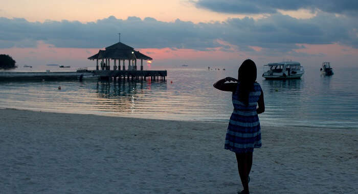backshot of woman on maldives beach