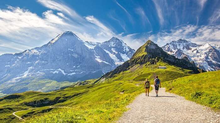 couple hiking in grindelwald