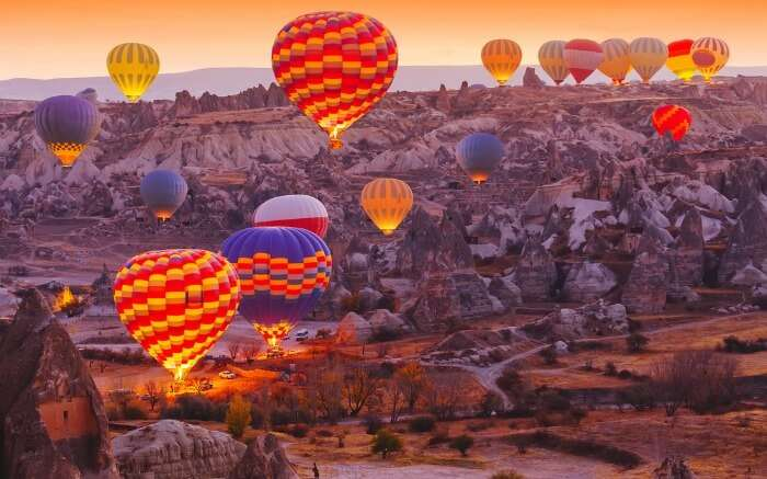 Hot air balloons flying over Cappadocia in Turkey in autumn