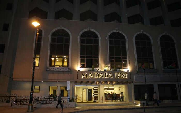 Madaba 1880 huge board at hotel entrance