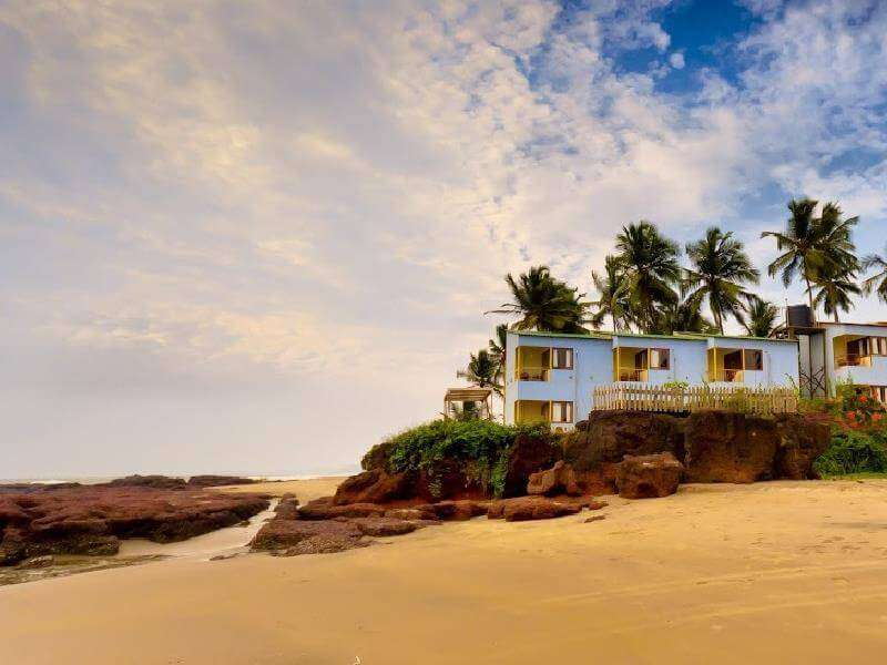 A beautiful hotel and coconut palm trees on a beach