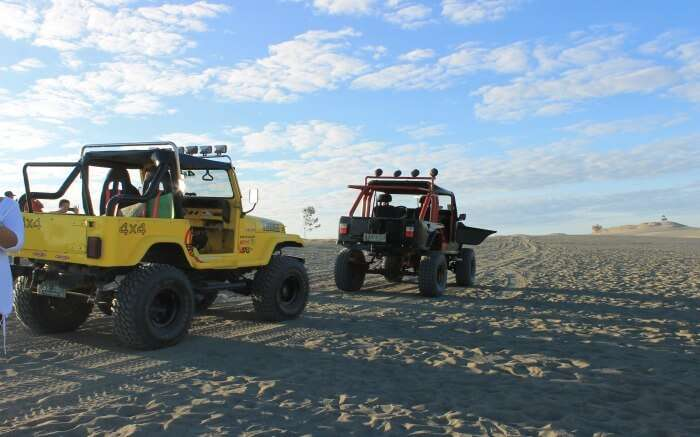 Safari jeeps parked in the dunes of Paoay in Ilocos Norte