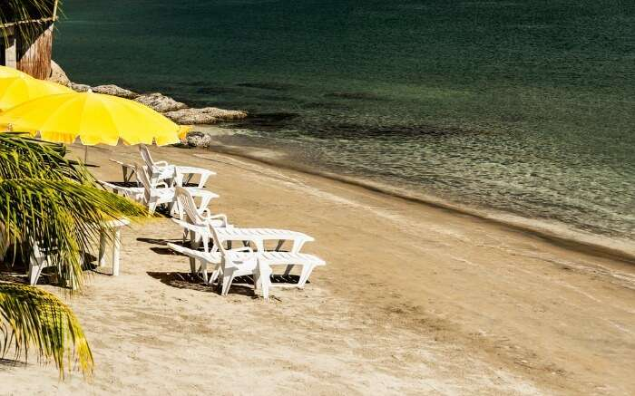 Yellow parasol recliners on Subic Bay beach