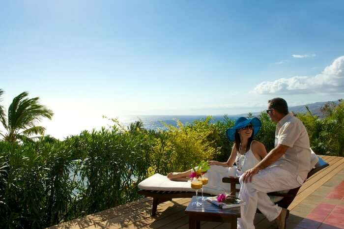 Couple spending private moments sitting in a resort in Reunion Island