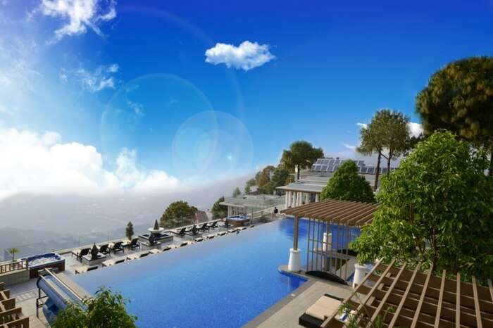 The majestic view of the vast nature from the infinity pool of Moksha Spa in Solan