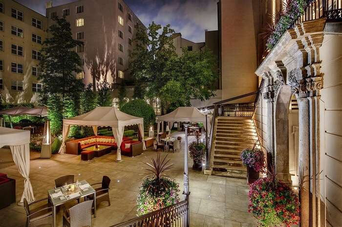 An outdoor dining facility at The Grand Mark that is one of the most romantic hotels in Prague