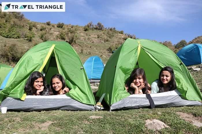 Girls relaxing in their tents at the campsite of Bir Billing