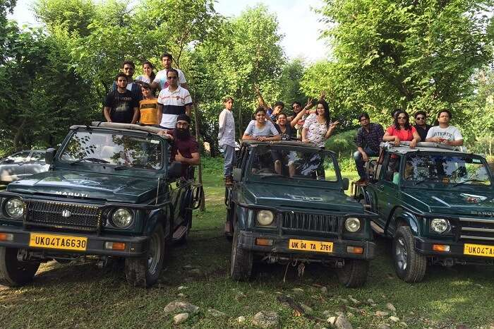 Travelers after completing a jeep safari in Jim Corbett