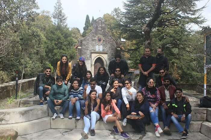 A group of travelers pose outside a tourist attraction in Lansdowne