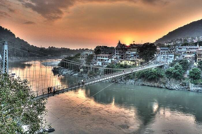 A sunset view of the Laxman Jhula and the city of Rishikesh