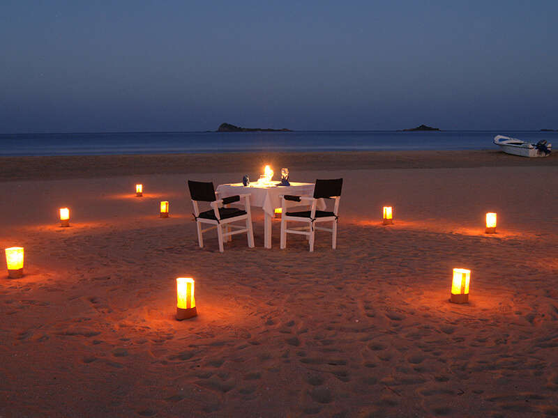 a candlelit dinner on a beach