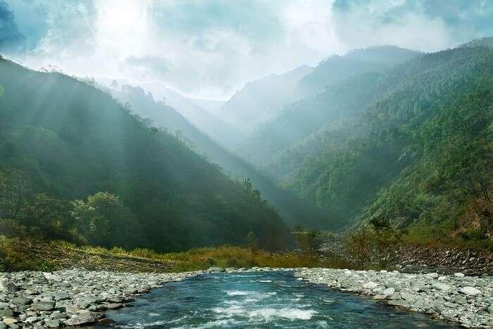 Sun rays reaching the river water near Shimla