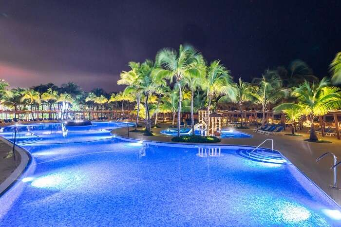 Swimming pool at a luxury Caribbean resort at night