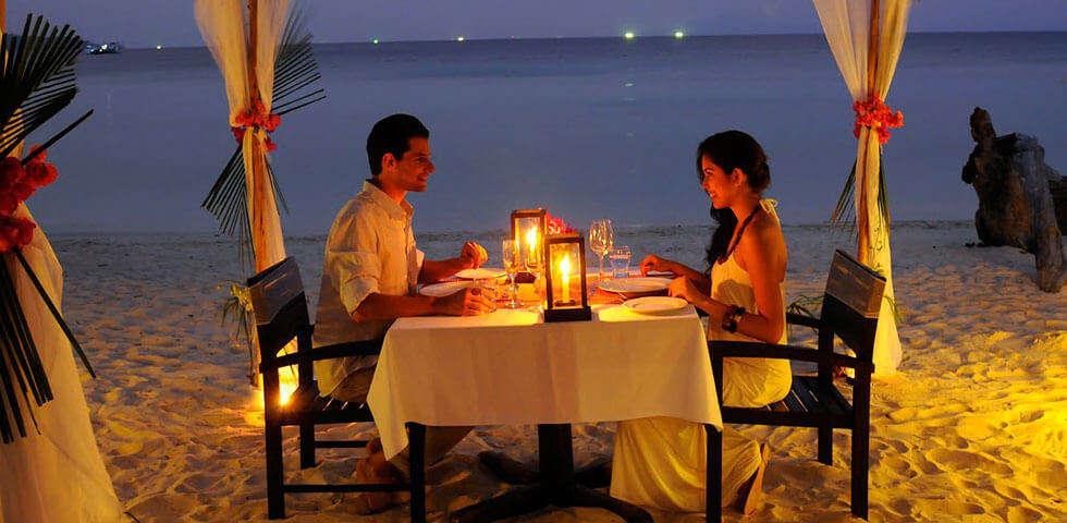 Romantic dinner setting on a beach