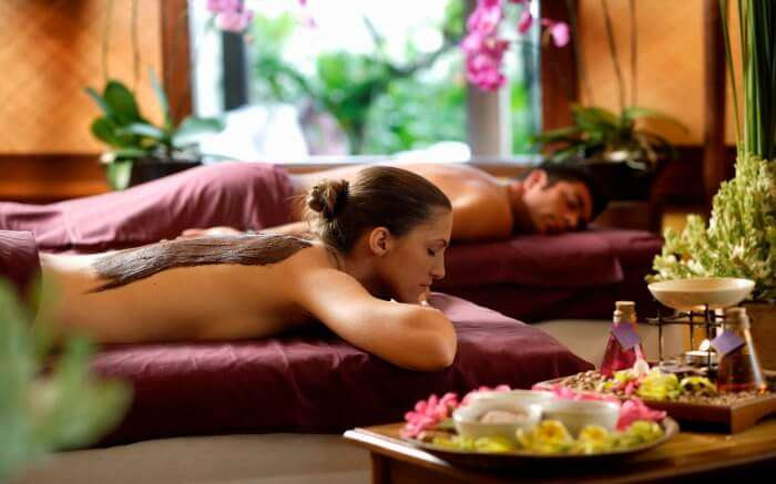 A couple getting a Balinese massage in a spa center