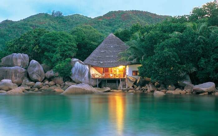 A hut style room by the water