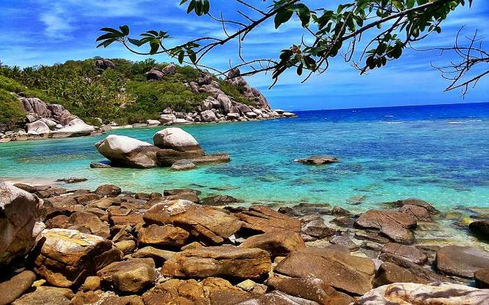 A rocky beach with blue waters