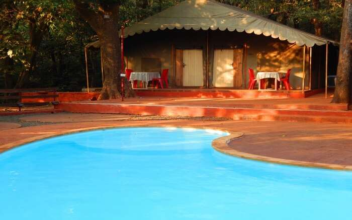 A tented accommodation of Westend Hotel by the swimming pool in Matheran