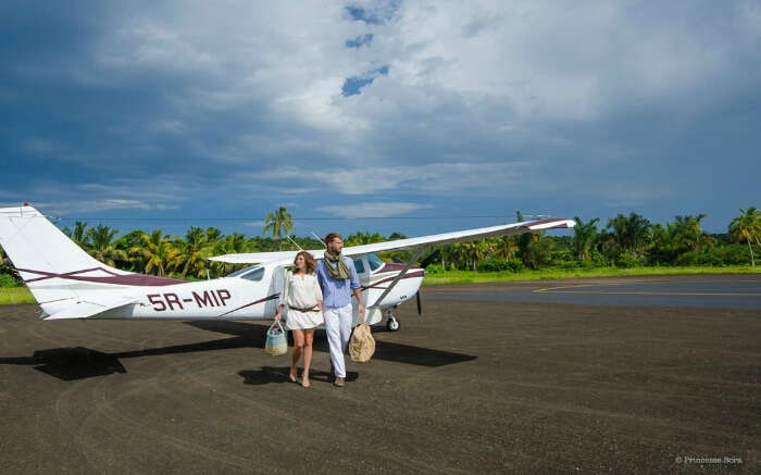 Couple coming out of a seaplane in Madagascar