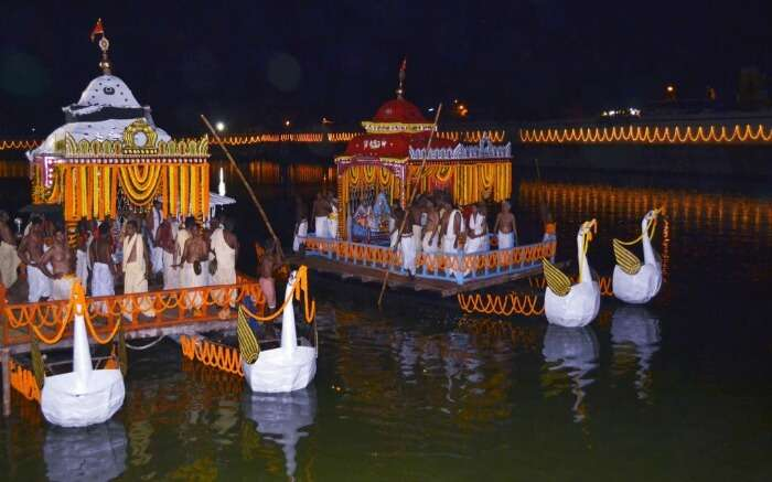 Decorated boats on a river during a festival in Tripura