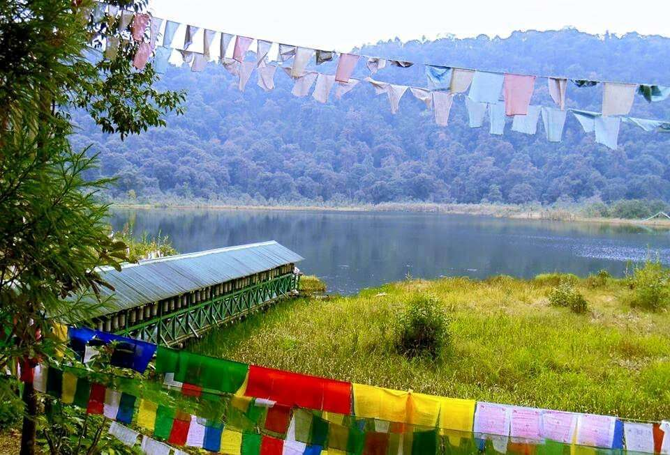 colorful prayer flags in hills