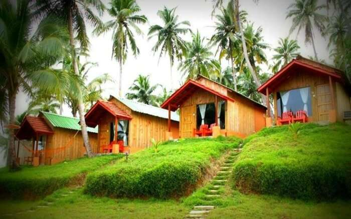 Picturesque cottages of The Oceanus Resort lined up by the seaside in Port Blair