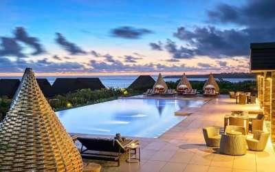 Stylish bamboo cabanas near an infinity pool in a resort