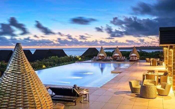 Stylish bamboo cabanas near an infinity pool in a resort1