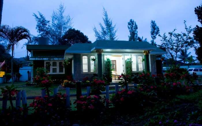 The front of the main bungalow of Bird of Paradise Homestay in Coorg